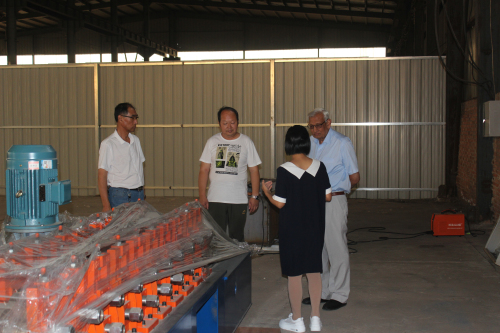 Uganda customer visited our factory for buying metal profile roll forming machines